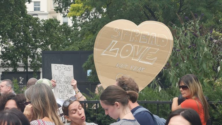 They carried signs calling to 'spread love not fear'