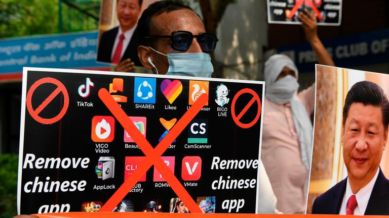Members of the Working Journalist of India (WJI) hold placards urging citizens to remove Chinese apps and stop using Chinese products during a demonstration against the Chinese newspaper Global Times, in New Delhi on June 30, 2020.