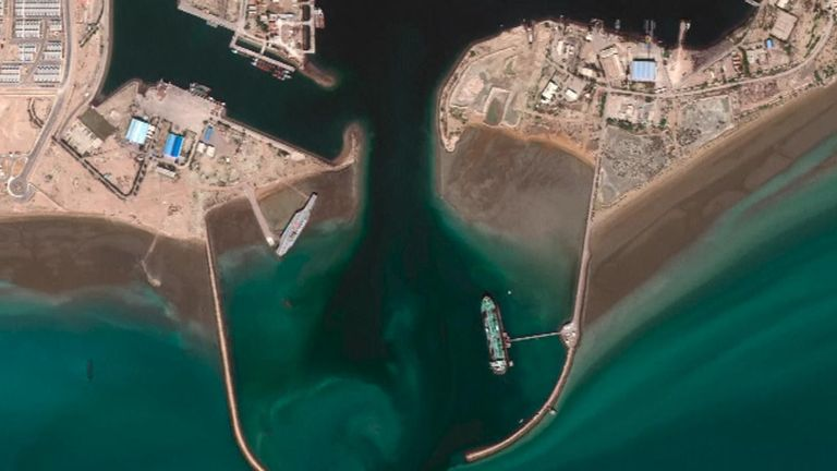 The mock aircraft carrier, left, has been seen in satellite images