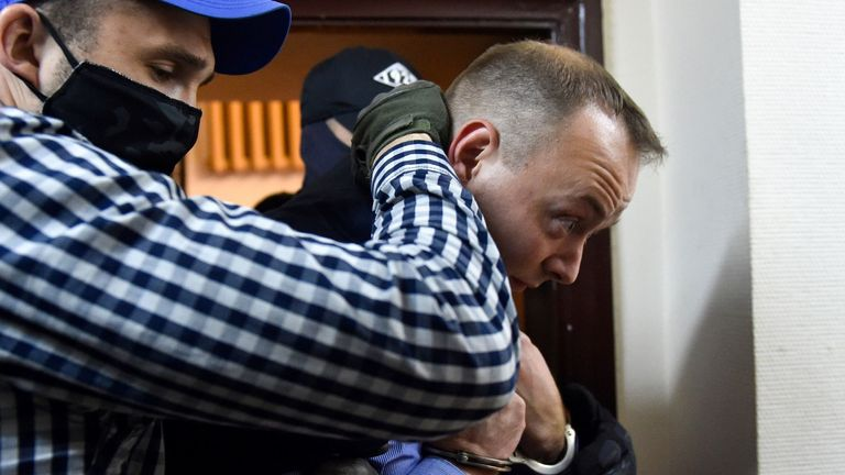 Ivan Safronov is escorted inside a court building after being detained on charges of treason