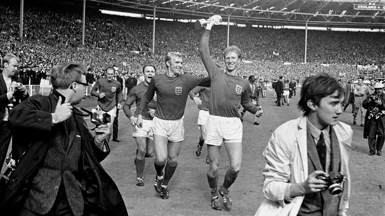 Jack Charlton (R) holds the Jules Rimet trophy aloft after England's 1966 World Cup win at Wembley
