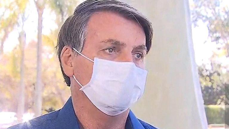Brazil's president tells reporters he has COVID-19