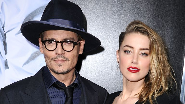 "Johnny Depp and Amber Heard arrive at the ""3 Days To Kill"" at ArcLight Cinemas on February 12, 2014 in Hollywood, California."