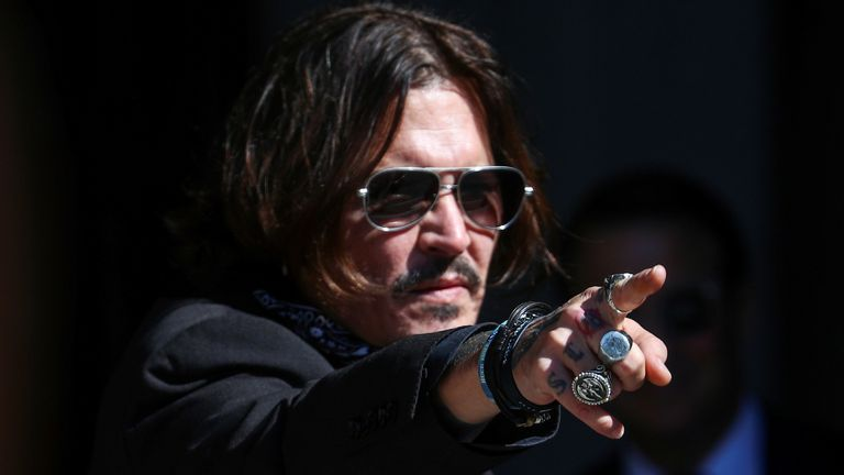 Actor Johnny Depp gestures as he arrives at the High Court in London, Britain July 22, 2020. REUTERS/Hannah McKay