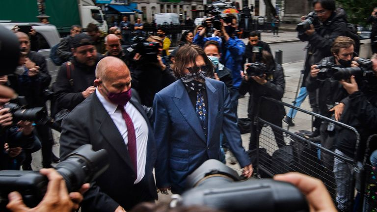 "Actor Johnny Depp arriving at the High Court in London for a hearing in his libel case against the publishers of The Sun and its executive editor, Dan Wootton. PA Photo. Picture date: Thursday July 9, 2020. 57-year-old Depp is suing the tabloid's publisher News Group Newspapers (NGN) over an article which called him a ""wife beater"" and referred to ""overwhelming evidence"" he attacked Ms Heard, 34, during their relationship, which he strenuously denies. See PA story COURTS Depp. Photo credit should read: Victoria Jones/PA Wire"