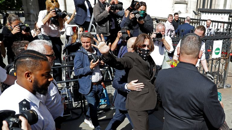 Actor Johnny Depp gestures as he arrives at the High Court in London, Britain July 22, 2020. REUTERS/Peter Nicholls??