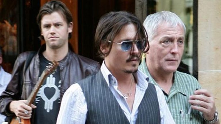 Johnny Depp pictured with then assistant Stephen Deuters (left) and late security guard Jerry Judge