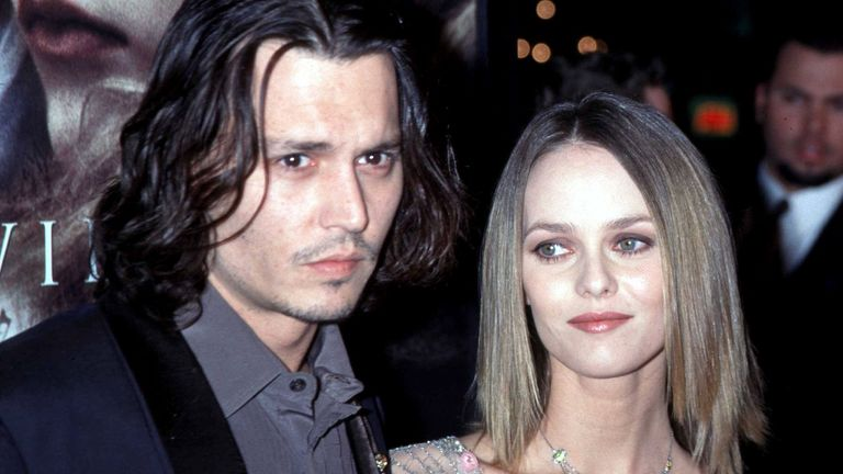 "Johnny Depp with his then girlfriend Vanessa Paradis at the Los Angeles premiere of his movie ""Sleepy Hollow"" in 1999"