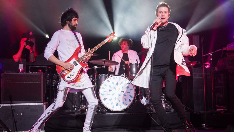 Serge Pizzorno and Tom Meighan (R) performing at the Royal Albert Hall in 2018