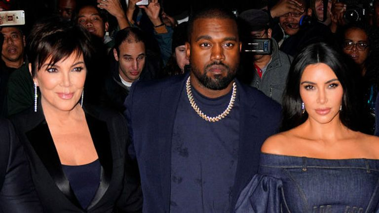 (L-R) Kris Jenner, Kanye West and Kim Kardashian West pictured in 2019