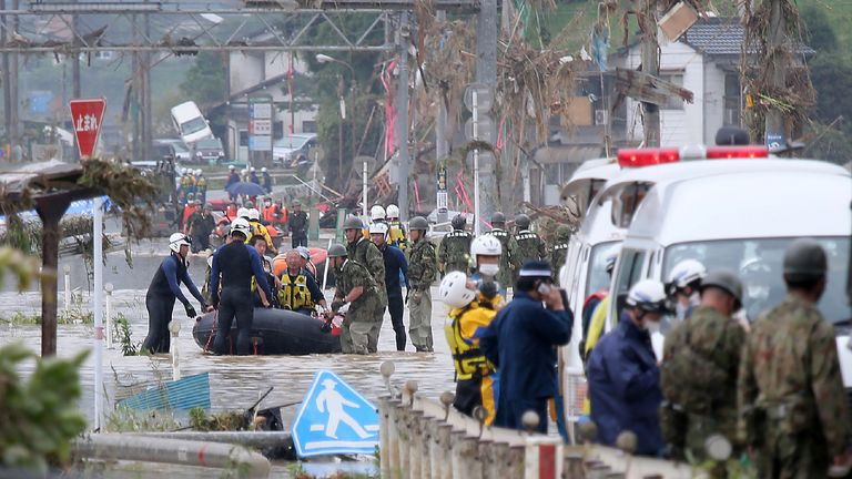 Residents are evacuated from flood-affected area by rubber boats in Kuma village, Kumamoto prefecture, on July 5, 2020