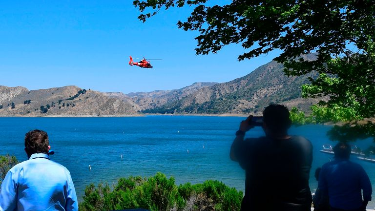 A helicopter searches over Lake Piru in Ventura County, California on July 9, 2020 for former Glee actress Naya Rivera