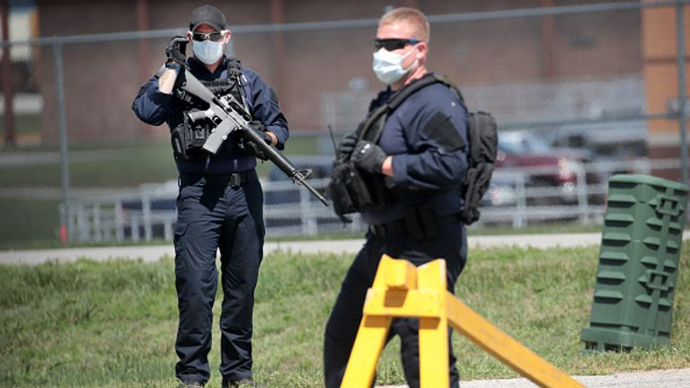 Guards outside the Indiana prison on Monday