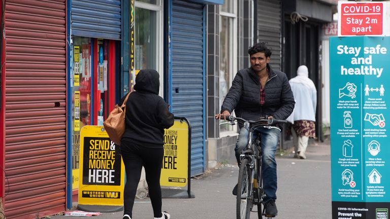 A man cycles along Belgrave Road in Leicester