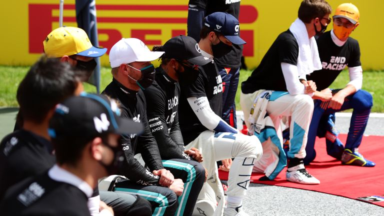 Lewis Hamilton (centre) and other F1 drivers including Valtteri Bottas and Pierre Gasly take a knee ahead of the Styrian Grand Prix in Spielberg, Austria