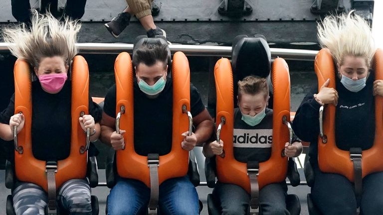 "Members of the public wear face masks as they ride the ""Oblivion"" rollercoaster at Alton Towers on July 4, 2020 in Alton, England. The popular theme park reopens with coronavirus safety measures in place today, after the British government eased the coronavirus restrictions in England to allow some leisure and hospitality businesses to reopen after more than 3 months in lockdown"