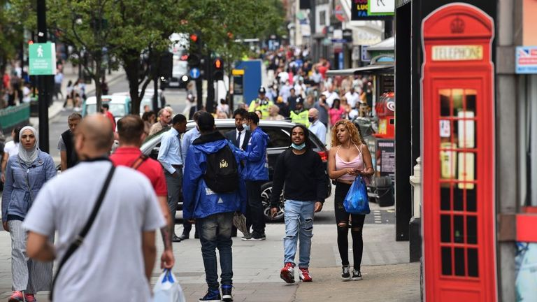 Shoppers walk a a busy Oxford Street in London on June 15, 2020 as some non-essential retailers reopen from their coronavirus shutdown. - Various stores and outdoor attractions in England are set to open Monday for the first time in nearly three months, as the government continues to ease its coronavirus lockdown. (Photo by Glyn KIRK / AFP) (Photo by GLYN KIRK/AFP via Getty Images)