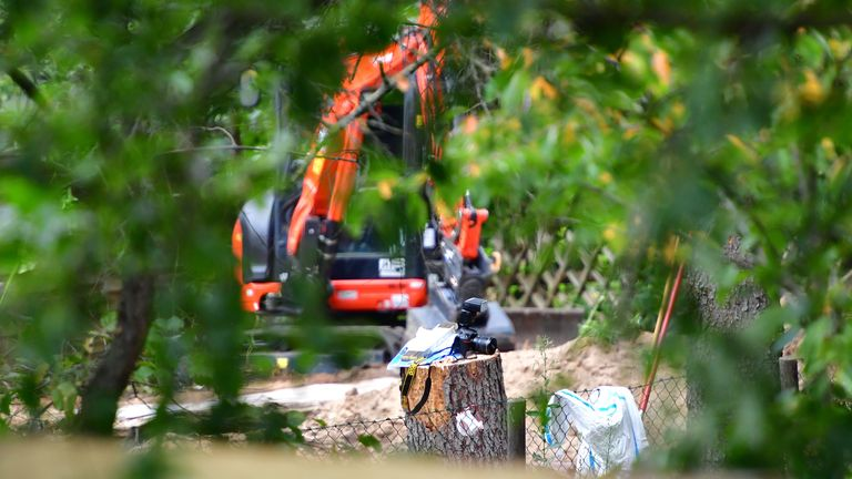 HANOVER, GERMANY - JULY 28: A camera is seen in front of a digger during a search at an an allotment garden on July 28, 2020 in Hanover, Germany. German Investigators are searching an allotment that belonged to Christian Brueckner, who has been named as the prime suspect in the disappearance of British child Madeleine McCann. Madeleine McCann disappeared from an apartment in Praia Da Luz, Portugal while on holiday with her parents and twin siblings in May 2007. (Photo by Alexander Koerner/Getty