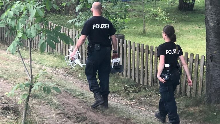 German police at a former home of the suspect in the Madeleine McCann case