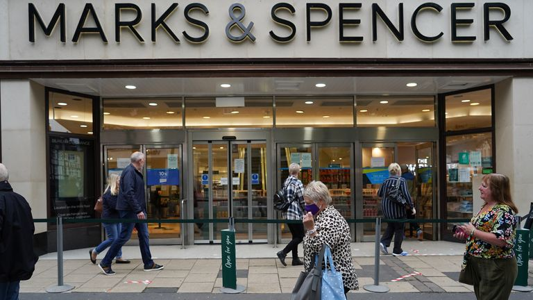 YORK, UNITED KINGDOM - JUNE 15: Customers queue to enter Marks and Spencer in York as non-essential stores prepare to reopen on June 15, 2020 in York, United Kingdom.
