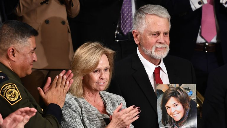 Marsha and Carl Mueller, pictured here with a photo of their daughter, want the terrorists to be tried in the US