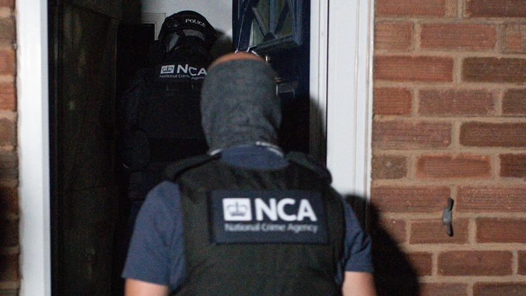 National Crime Agency and police raid a property in Birmingham using information o btained from EncroChat