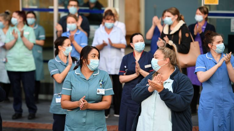 Members of staff at Leeds General Infirmary participate in the national NHS celebration clap
