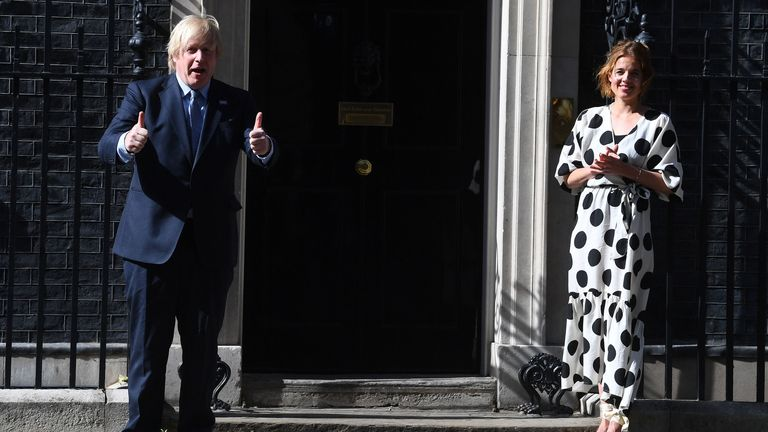 Boris Johnson and Annemarie Plas, founder of Clap For Our Carers, join in the pause for applause to salute the NHS 72nd birthday