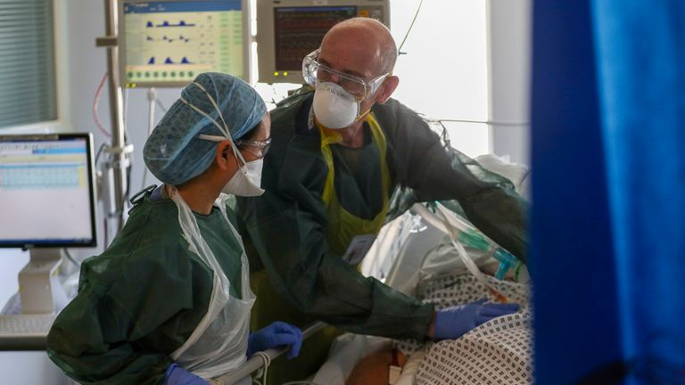 Doctors treat a patient suffering from coronavirus at Frimley Park Hospital in Surrey
