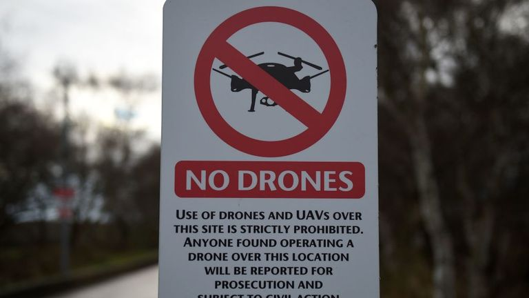 "A ""No Drones"" sign alerting members of the public that the use of drones or unmanned aerial vehicles (UAV) is prohibited, is pictured outside Manchester United's Carrington Training complex in Manchester, north west England on December 20, 2018. - London Gatwick Airport was forced to suspend all flights Thursday due to drones flying over the airfield, causing misery for tens of thousands of stuck passengers just days before Christmas. (Photo by Oli SCARFF / AFP) (Photo credit should read OLI SCA"