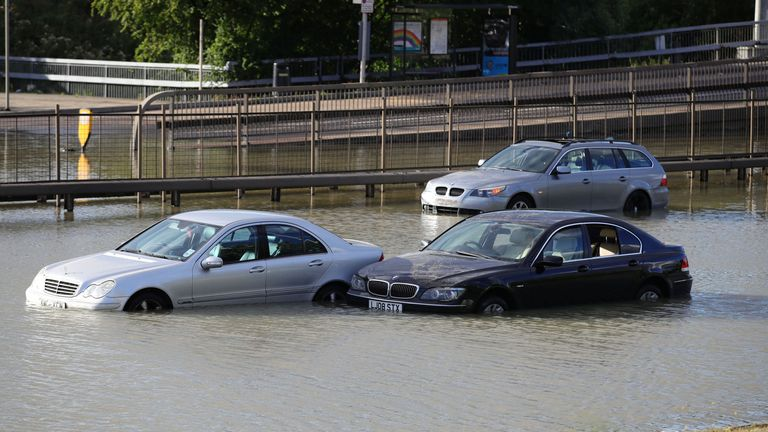 Cars were trapped in the water after a pipe burst