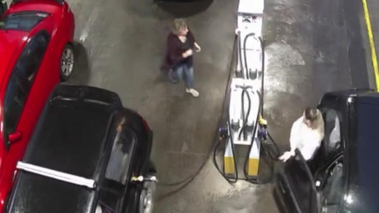A woman narrowly missed serious injury when a motorist drove off with a petrol pump still attached to their car
