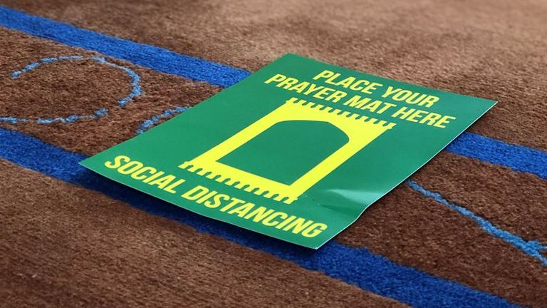 New markers show people where to put their prayer mats