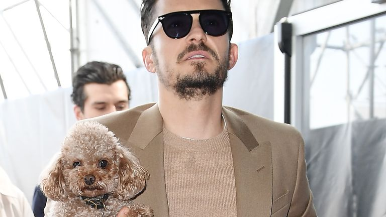 MILAN, ITALY - FEBRUARY 23: Orlando Bloom with his dog Mighty attend the Boss fashion show on February 23, 2020 in Milan, Italy. (Photo by Jacopo Raule/WireImage)