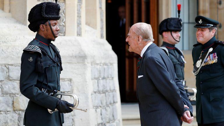 The Duke of Edinburgh speaks to a bugler at Windsor Castle