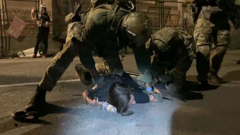 Federal agents restrained Noelle Mandolfo and knelt on her back while detaining her during a protest in Portland, Oregon