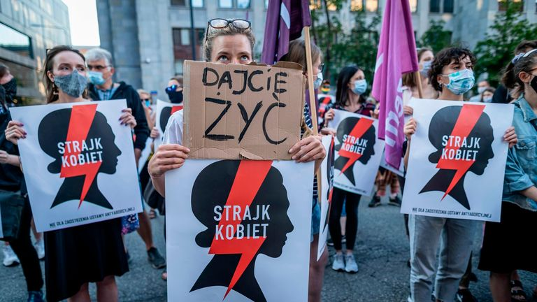 "Protesters hold banners reading ""Let us live"" and ""Women's Strike"" as they take part in protest against the Polish government plans to withdraw from the Istanbul Convention on prevention and combatting of home violence, in Warsaw, Poland on July 24, 2020"