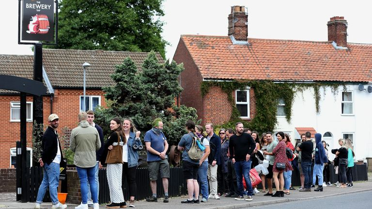 Customers queue outside the Fat Cat Brewery Tap pub in Norwich as lockdown restrictions are eased in England