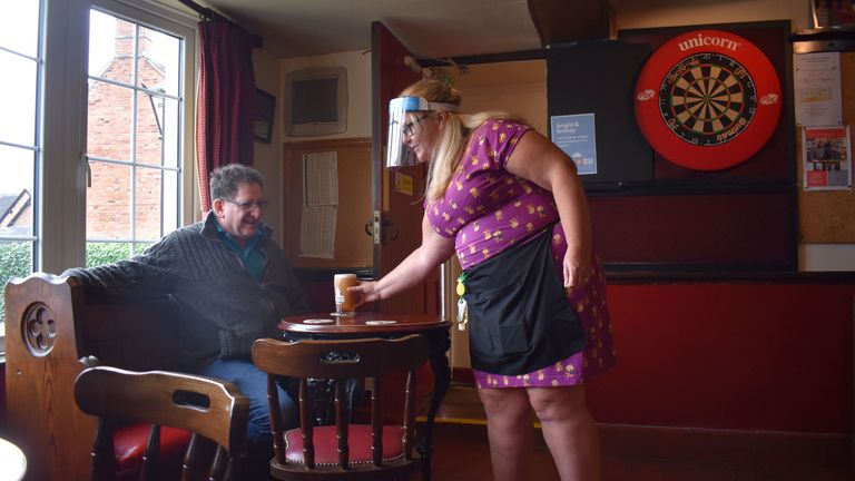 Landlady Katy Boulter serves a pint to the national chairman of Camra, Nik Antona, at his local pub, the Royal Oak in Barton-under-Needwood, Staffordshire