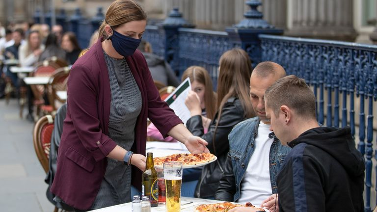 Meals are served on the street at Di Maggio's outdoor restaurant area in Glasgow city centre