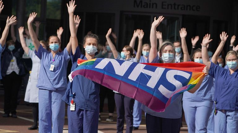 NHS staff outside the Royal Victoria Infirmary, Newcastle, join in the pause for applause to salute the NHS 72nd birthday