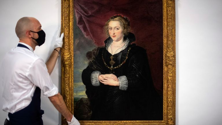 A Sotheby's technician with the rediscovered Rubens portrait