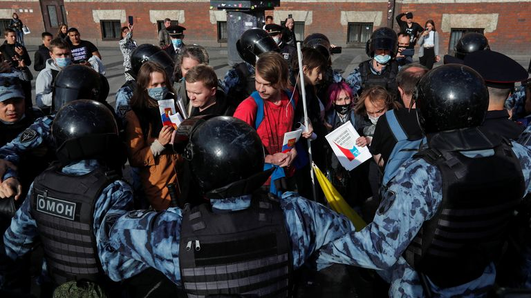 Officers block protesters at a rally in Saint Petersburg