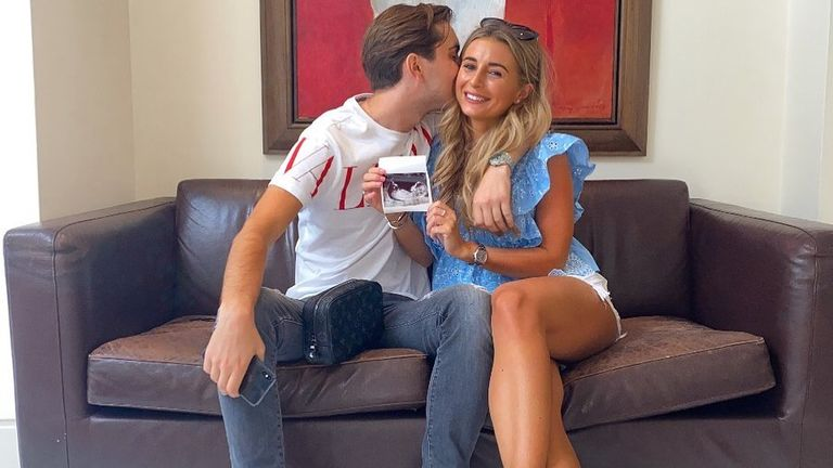 Dani Dyer and her partner Sammy Kimmence posed with an image of the baby scan