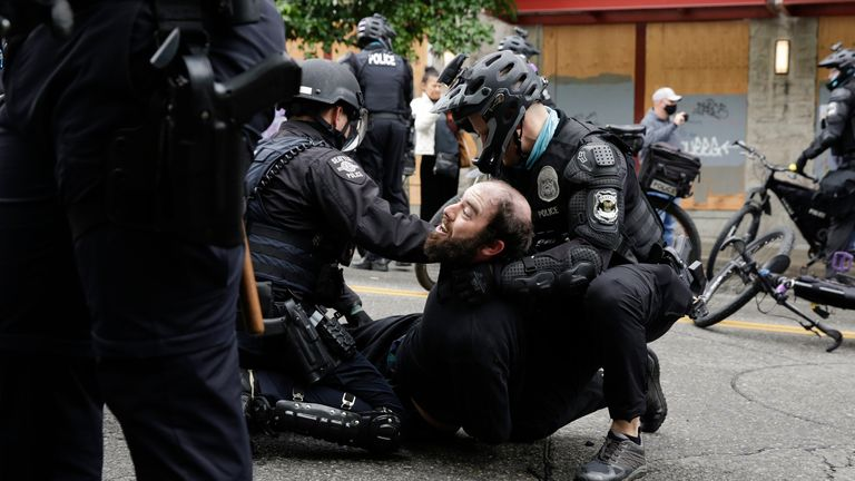 Protester arrested at Seattle's Capitol Hill Occupied Protest (CHOP) in Seattle, Washington on July 1, 2020