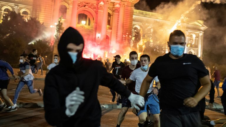 Police fired tear gas at hundreds of demonstrators who tried to storm the Serbian parliament on the fourth night of protests