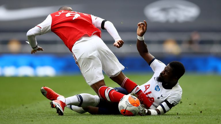 Serge Aurier (right) pictured playing for Spurs against Arsenal on Sunday just hours before his brother died