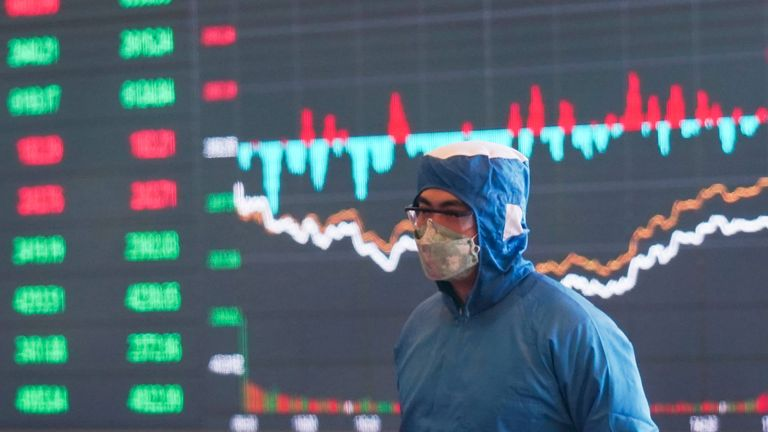 A member of staff wears protective equipment at the Shanghai Stock Exchange building