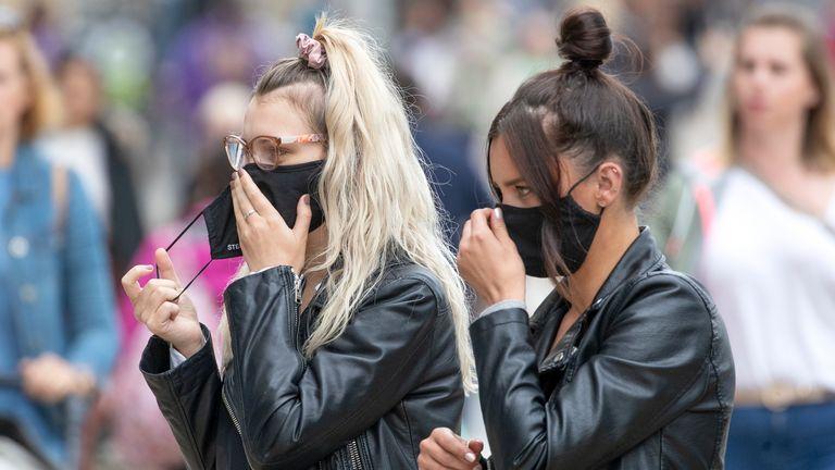 Shoppers wear protective face masks in Edinburgh's Princes Street.