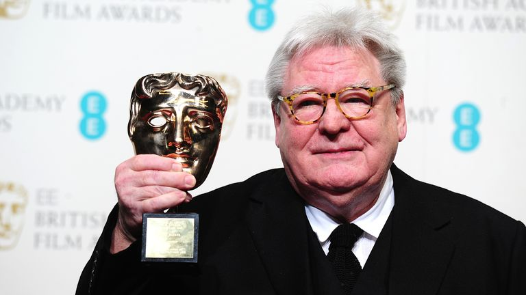 Sir Alan Parker with the award for Fellowship in the press room at the 2013 British Academy Film Awards at the Royal Opera House, Bow Street, London